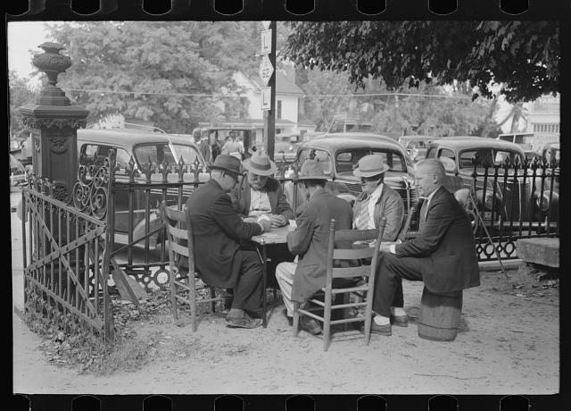 Members of the community playing cards in front of the courthouse, Yanceyville, Caswell County, North Carolina