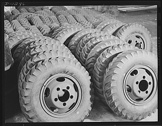 Army truck manufacture (Dodge). Spare wheels and tires by the hundreds for Army trucks are piled up in the Dodge Company's Lynch Road plant, in Detroit. Approximately 250 sets are required for each day's production. This makes a tremendous stock covering a huge arsenal at the plant