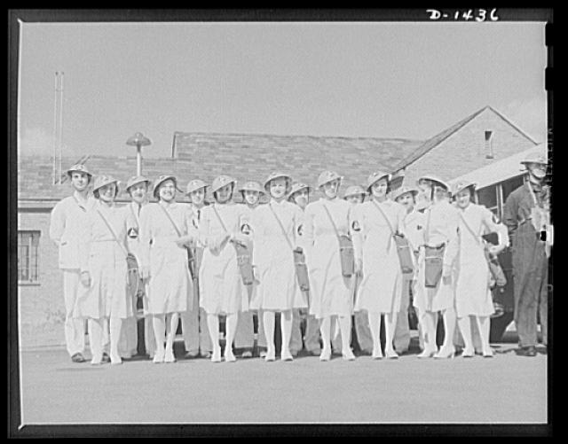 Civilian protection. Nurses' aides and medical corps personnel turn out for drill. These two groups make up the personnel of stretcher bearers, first aid squads, casualty clearance stations, and first aid posts. Both are also assigned to hospital work in a rigorous course of training and hospital experience which is necessary to become members of their groups