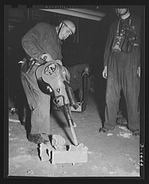 Civilian defense. A police emergency worker shows how Warsop asoline rockbreaker works. The two-cycled engine delivers 2300 blows per minute, and can be used to break through walls to release trapped persons. The demonstration was at the civilian defense show at Madison Square Garden, New York