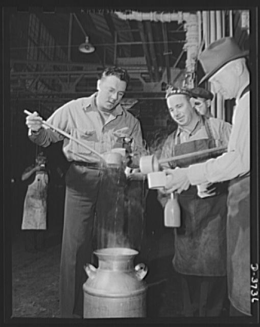 "Soup line, 1942. Skilled workers, engaged in converting a huge automobile plant to army tank production, ""freshen up"" on an overtime job with hot soup and coffee. Ford Lincoln plant, Michigan"