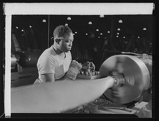 Manpower. Negro aircraft propeller workers. American Negroes are contributing their skills to war production. This lathe operator in a large Eastern airplane propeller factory is performing a delicate operation on the ring of the blade. Curtiss-Wright Propeller Division, Caldwell, New Jersey