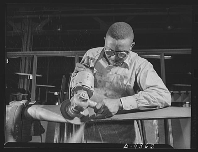 Manpower. Negro aircraft propeller workers. America draws its manpower from various races for the war production drive. This skilled Negro worker is grinding profile and radius on the leading edge of a blade in a large Eastern propeller factory. Even the slightest mistake in this operation may ruin the entire blade. Curtiss-Wright Propeller Division. Caldwell, New Jersey