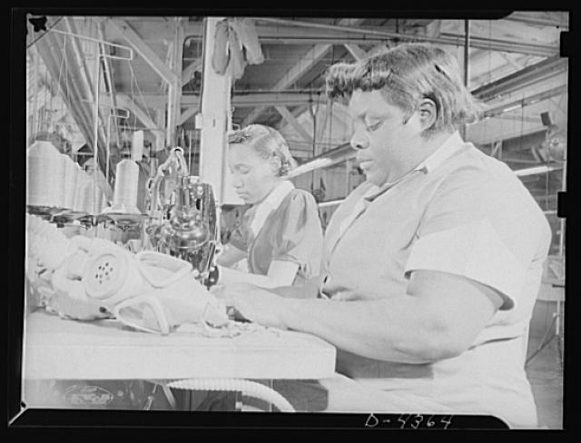 Manpower. Negro aircraft workers. Workers of various races contribute their skills to war industry. To safeguard American cities against all contingencies, these workers in an Eastern arsenal are sewing hand harness tabs on gas masks, which are being turned out in mass production volume. Edgewood Arsenal. Edgwood, Maryland