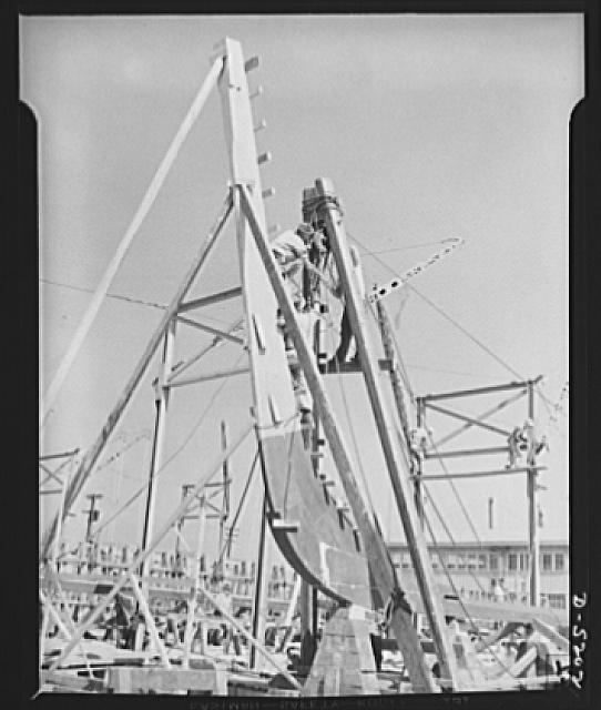 Production. Minesweepers. The stem of a new minesweeper is fitted to its keel in an Eastern shipyard. Painstaking, skilled craftsmen fit every joint to exact dimensions. Gibbs Cass Company