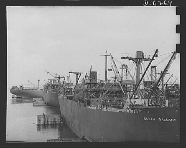 Ship launching in Portland, Maine. Some of the five British cargo-carrying ships built under lend-lease at a large New England yard and launched along with two destroyers and one liberty ship at a record breaking mass launching August 16, 1942