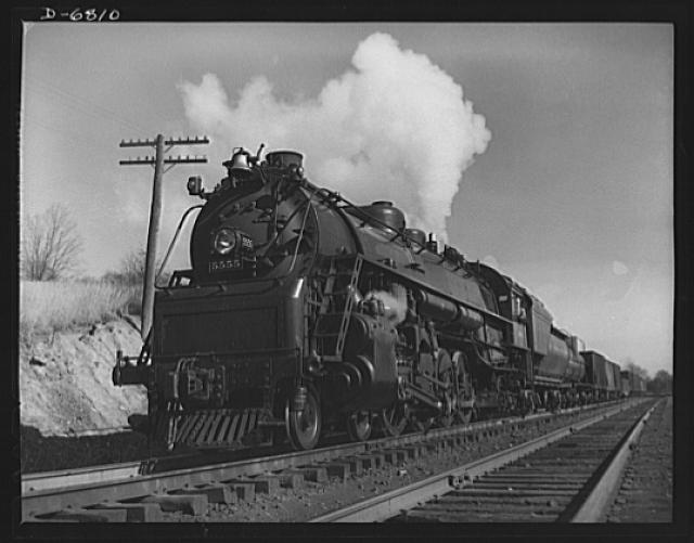 "Transportation. Engines. ""MacArthur"" engine in service on the Baltimore and Ohio Railroad. Engine is shown at Halethorpe, Maryland, about eight miles from Baltimore, pulling a freight train"