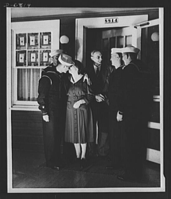 Thanksgiving, 1942. Four of Mr. and Mrs. Wayman E. Fincham's six warrior sons return to their home in Silver Spring, Maryland, for Thanksgiving. Five of the brothers joined the Coast Guard and the other enlisted in the Army. The oldest brother is with Uncle Sam's fighting forces overseas, and the youngest is in training. Mr. and Mrs. Fincham proudly display six stars in the window of their home to tell the world their sons are fighting for freedom
