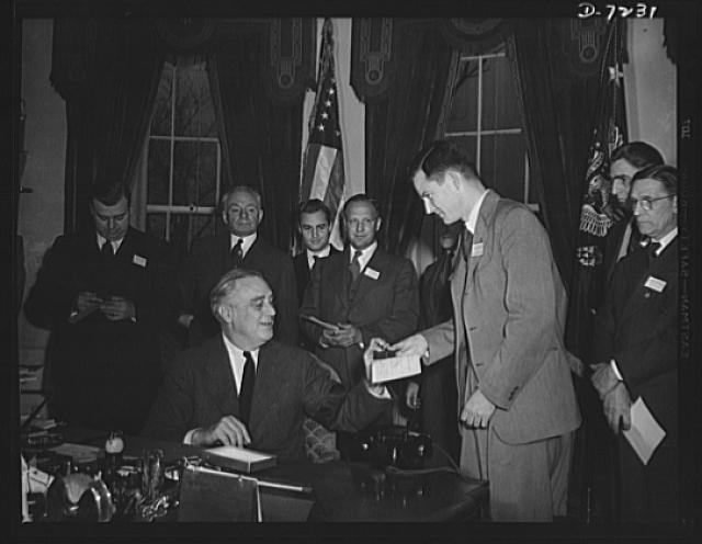 Citation winners. President Roosevelt, awarding a citation to James A. Merrill, an employee of the Goodyear Tire and Rubber Company, Akron, Ohio