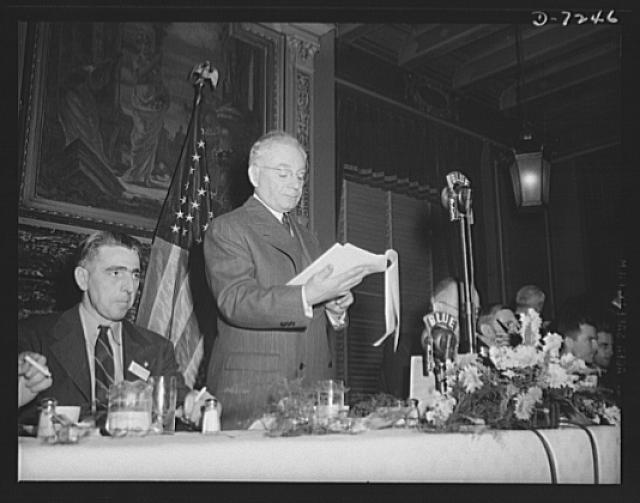 Citation winners. William G. Marshall, Director of the War Production Drive, introduces the workers at a luncheon tendered to them by  Donald M. Nelson, Chairman of the War Production Board (WPB), following the White House ceremony. At left is Daniel W. Mallett, certificate winner from Mechanics Universal Joint Division, Borg-Warner Corporation, Rockford, Illinois
