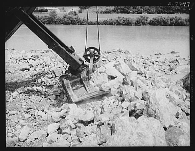 Tennessee Valley Authority. Construction of Douglas Dam. Loading out rock for crushing into aggregate for concrete work at TVA's new Douglas Dam on the French Broad River. This dam will be 161 feet high and 1,682 feet long, with a 31,600 acre reservoir area extending forty-three miles upstream. With a useful storage capacity of approximately 1,330,000 acre-feet this reservoir will make possible the addition of nearly 100,000 kilowatts of continuous power to the Tennessee Valley Authority system in dry years and almost 170,000 kilowatts in the average year