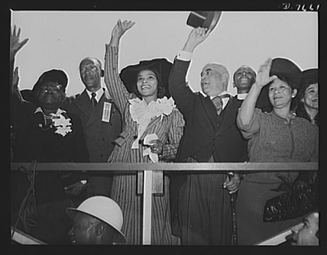 Production. Launching of the SS Booker T. Washington. Mrs. Mary McLeod Bethune, Director of Negro Affairs, National Youth Administration (NYA); an identified member of the local committee; Marian Anderson, celebrated contralto; Dr. William J. Thompkins, Recorder of Deeds, Washington, D.C.; Reverend F.D. Jordon, Los Angeles; and Mrs. Portia Washington Pittman, only living daughter of Booker T. Washington, wave farewell as the Liberty Ship named for the great Negro educator and leader, slides down the ways at the California Shipbuilding Corporation's yards at Wilmington, California