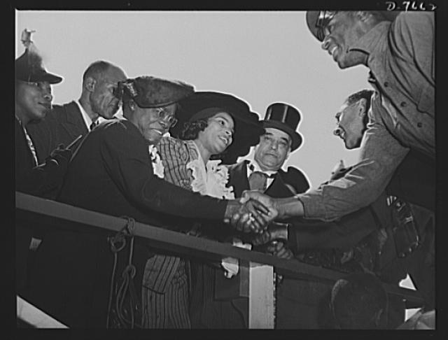 Production. Launching of the SS Booker T. Washington. Mrs. Mary McLeod Bethune, Director of Negro Affairs, National Youth Administration (NYA); Marian Anderson, celebrated contralto; and Dr. William J. Thompkins, Recorder of Deeds, Washington, D.C., congratulate Negro workmen who helped construct the SS Booker T. Washington, first Liberty Ship named for a Negro