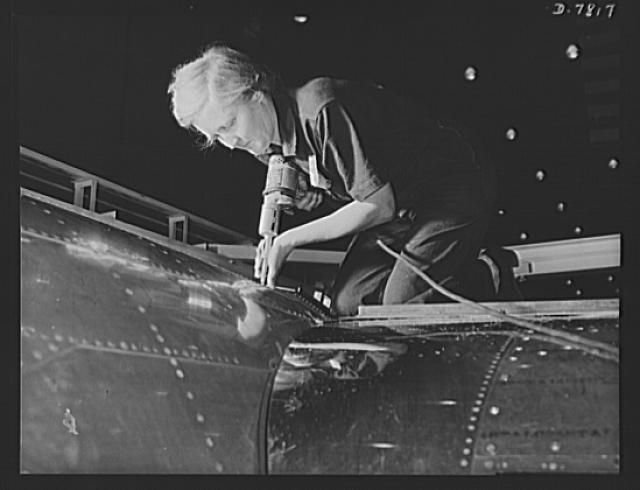 "Production. B-17F heavy bombers. A women worker, over 60 years old, does an expert riveting job on a B-17F bomber in the Long Beach, California, plant of Douglas Aircraft Company. Better known as the ""Flying Fortress,"" the B-17F is a later model of the B-17, which distinguished itself in action in the South Pacific, over Germany and elsewhere. It is a long range, high altitude, heavy bomber with a crew of seven to nine men and with armament sufficient to defend itself on daylight missions"