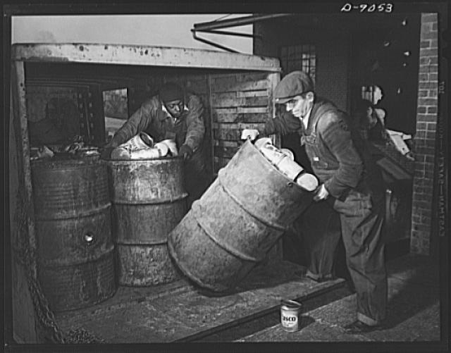 Conversion. Rendering of household fats. Household waste fats, in the tin cans in which America housewives saved them, arrive at a rendering plant. The steel drums in which the cans are packed make many round trips between the plant and the meat markets at which the fats are collected