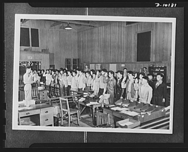 Japanese-American volunteers. The remaining fifty-three volunteers of board no. 2, Lihue, Kauai, who passed their physical to complete their board's quota of fifty-eight inductees take the oath of induction into the AJA [Americans of Japanese ancestry] combat regiment. The oath is administered by Major Charles V. McManus, adjutant of the Kauai Service Command