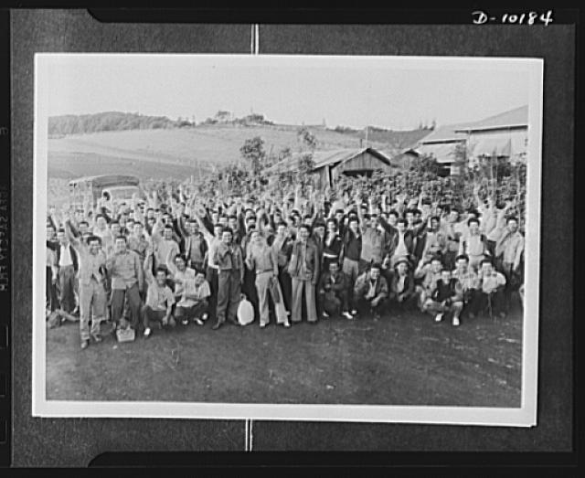 Japanese-American volunteers. AJA [Americans of Japanese ancestry] volunteers waiting for their physical examination at a military hospital on Kauai, first island actually to induct men into the new AJA combat unit, cheer loudly and give the V-for- Victory sign as they are told army doctors are ready to begin the examination. These men were all from local board no. 1 at Makaweli School, Hawaii
