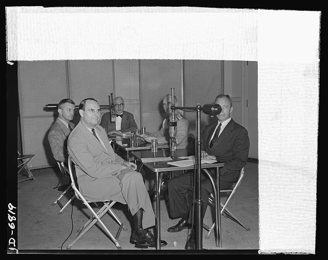 America's leaders discuss war needs in a radio program. America's leaders discuss the Army-Navy Production Awards and the critical needs of war production in a program on August 9, 1942. Vice Chairman of the War  Production Board (WPB) is in the foreground and Robert P. Patterson, Under Secretary of War, is in the right foreground. In the background are (left to right): James V. Forrestal, Under Secretary of Navy; Elmer Davis, Director of the Office of War Information (OWI); and Admiral William D. Leahy, Chief if Staff of the Commander-in-Chief of the Army and Navy