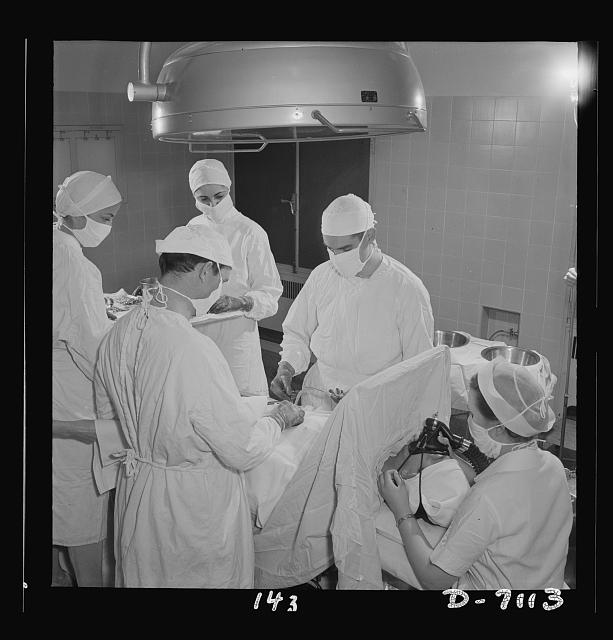 Nurse training. Young nurses assist at an appendectomy. This is part of the training with which every student nurse must be thoroughly conversant before she completes her training. With enough students to do this type of hospital work, graduate nurses can be released for duty with the armed forces