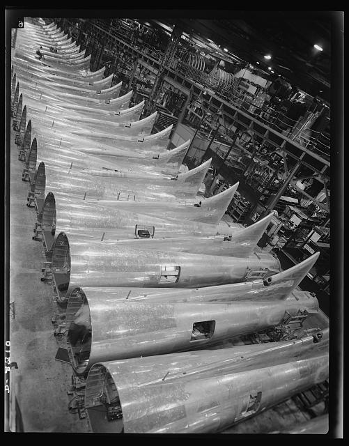 Production. B-17 heavy bomber. Tail sections of B-17F (Flying Fortress) bombers ready for assembly into the big warships of the air at the Boeing plant in Seattle. The Flying Fortress has performed with great credit in the South Pacific, over Germany and elsewhere. It is a four-engine heavy bomber capable of flying at high altitudes