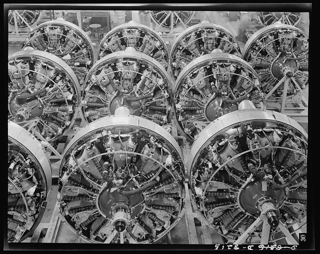 Production. B-17 heavy bomber. 1200-horsepower Wright engines for B-17F (Flying Fortress) bombers ready for installation on the mighty warships of air at the Boeing plant in Seattle. The Flying Fortress has performed with great credit in the South Pacific, over Germany and elsewhere. It is a four-engine heavy bomber capable of flying at high altitudes