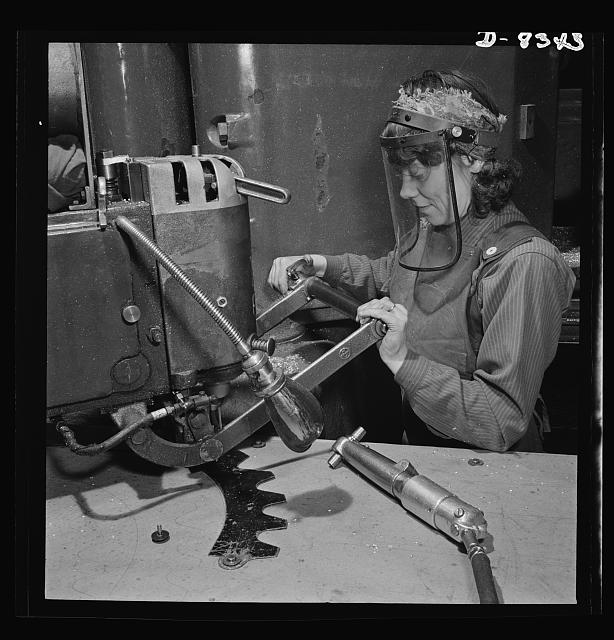 Production. B-17F heavy bomber. Mary Miller, operator of a router at the  Boeing plant in Seattle, drills holes in a part for a new B-17F (Flying Fortress) bomber. The Flying Fortress, a four-engine heavy bomber capable of flying at high altitudes, has performed with great credit in the South Pacific, over Germany and elsewhere