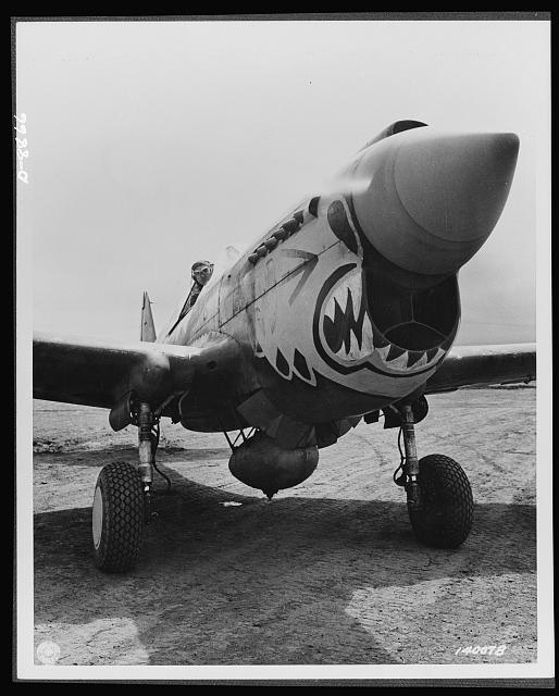 "Aircraft. Army. One of the redoubled ""Flying Tigers"" ready to take off from an Alaskan point in a Curtis P-40 ""Warhawk"" fighter plane. The group to which he belongs is commanded by Major John Chennault, son of the famous general. Planes of the series to which this belongs have seen action in almost every known theatre in England and"
