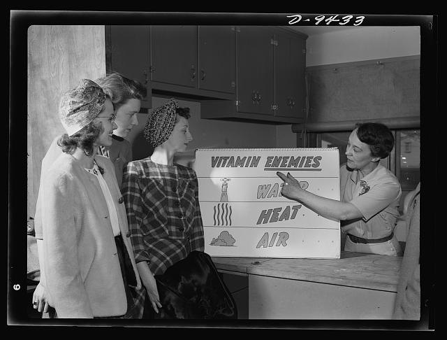 A wartime food demonstration in Alexandria, Virginia about preserving vitamin content in foods.