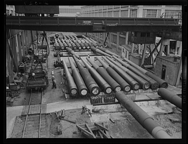 Guns for the Navy. Finished guns of large caliber awaiting shipment in an eastern Navy yard, one of eleven arsenals which are producing guns for the new two-ocean fleet