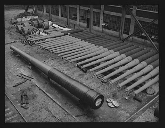 Guns in a gunyard. Finished guns of large caliber awaiting shipment in an eastern Navy yard, one of eleven arsenals which are producing guns for the new two-ocean fleet