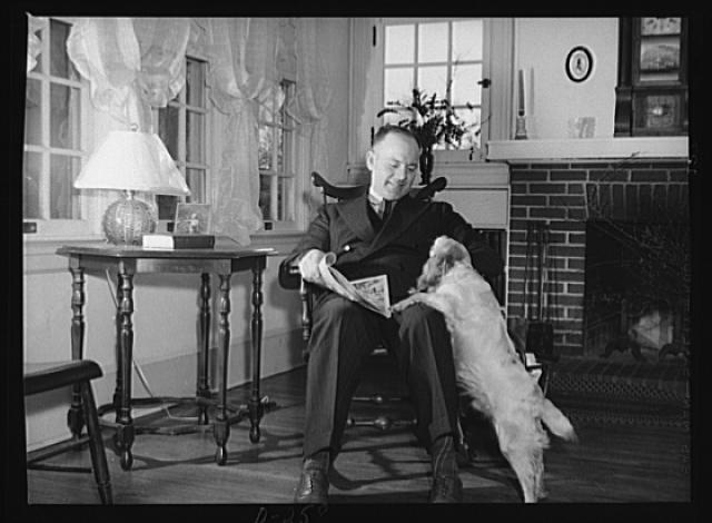 Shenandoah Valley. Mr. Dickinson, county agent, Shenandoah County, and chairman of the county defense committee. Mr. Dickinson is shown in the living room of his home in Woodstock, Virginia