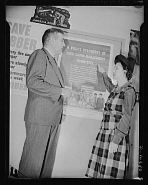 Left to right: Michael W. Straus, Chief, War Production Drive Headquarters, and Mrs. Marie McPherson, Chairman, Labor Mangagement Committee, Meissner Manufacturing Company, Mount Carmel, Illinois