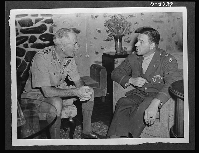 American military delegation calling on Haile Selassie. Before its audience with His Majesty, Haile Selassie, Emperor of Ethiopia, the American military delegation, paid a courtesy call on the British commanding officer of the Ethiopian area, Major General Samuel Butler, left. He is shown with Colonel Ewdin Clark, commanding officer of the U.S. Eritrean Service Command. These pictures are the first to be taken for publication since His Majesty's return to become a fighting member of the United Nations
