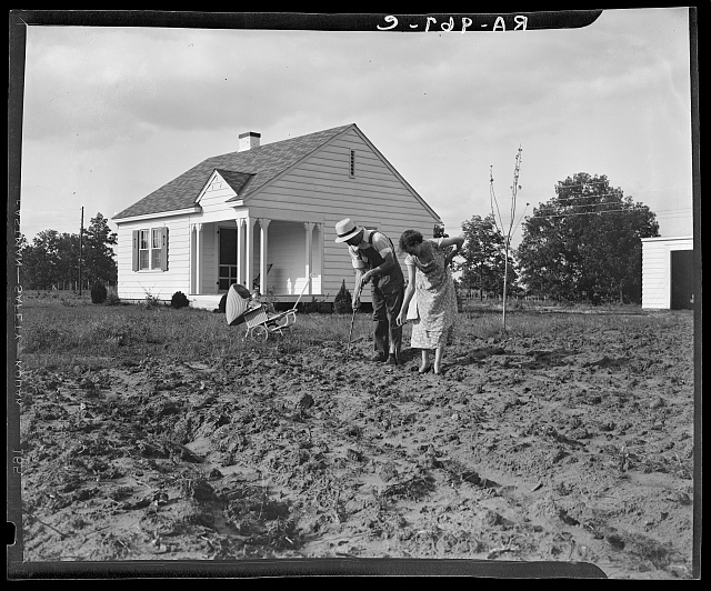 Homesteaders at work in front of their new house at Dallas, Texas