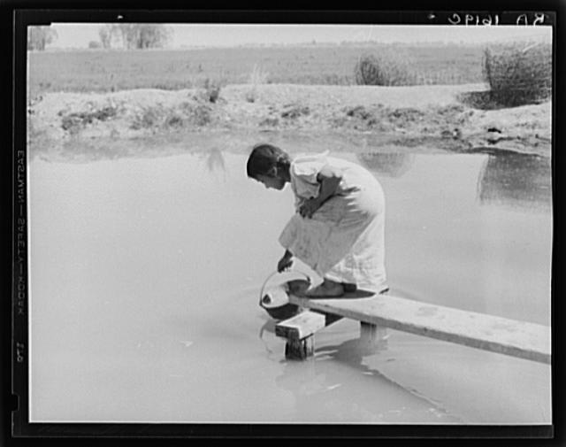 Drinking water for field worker&#39;s family. Imperial Valley, California, near El Centro
