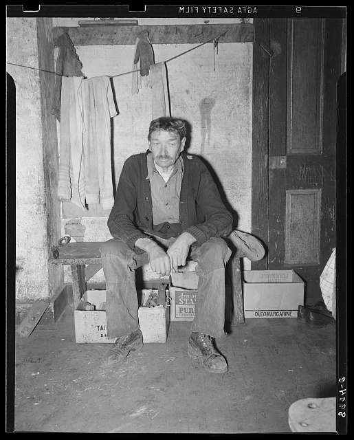 Old miner living in company house, rent free. He was injured while working in the mines several years ago, has been unable to work since. Company provides him free housing, and he lives on here, depending mainly on neighbors for food. Kempton, West Virginia