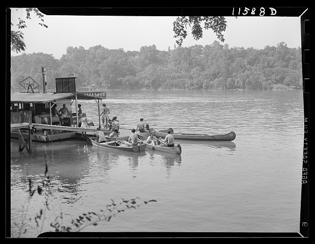 Washington, D.C. (vicinity). Canoes and rowboats tied up at small refreshment barge on the west bank of the Potomac River