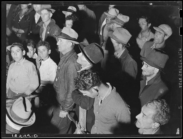 Street meeting at night in Mexican town outside of Shafter, California. Organizer for United Cannery Agricultural Packing and Allied Workers of America (Congress of Industrial Organizations-CIO) talks to mixed crowd. The strike failed