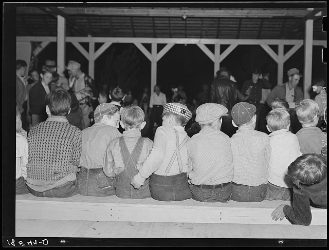 Young migrants waiting for signal to come for refreshments. Halloween party at Shafter camp for migrants, California