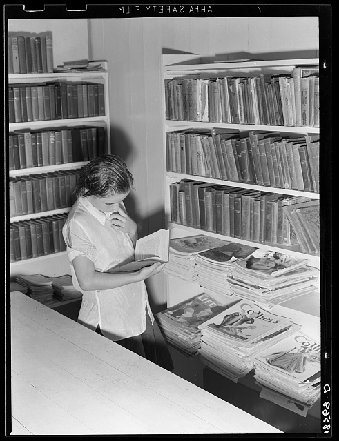 Arvin camp for migrant workers (Farm Security Administration-FSA) California. A small library in camp with Works Progress Administration (WPA) librarian in charge is now available to agricultural workers. Part of the program for recreational and education instituted in all government camps for migratory farm families