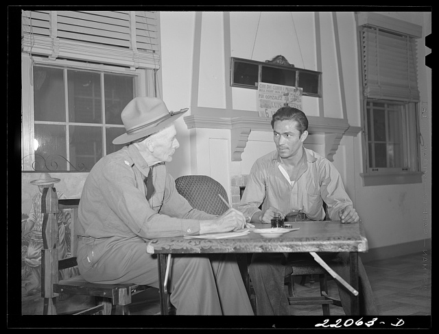 Brownsville, Texas. Retired army officer registering men for Selective Service at the Chamber of Commerce