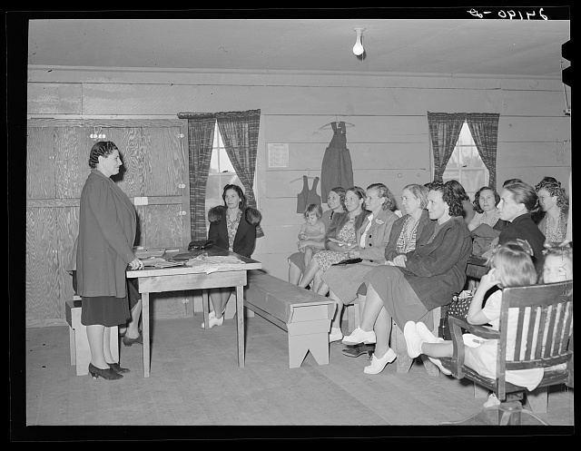 Presidents of ladies club addressing members. Tulare migrant camp. Visalia, California