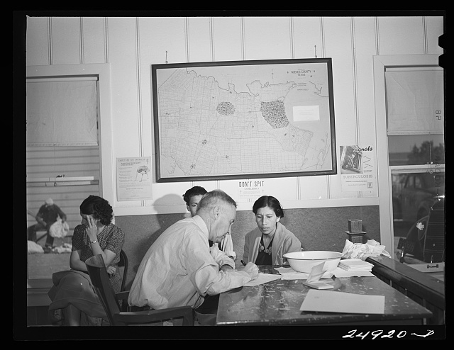 Corpus Christi, Texas. Privately supported tuberculosis clinic supervised by a retired doctor. Majority of patients are Latin-American. Doctor recording medical history of patient. Map shows number of cases in area