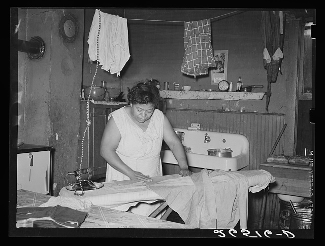 Steel worker's wife ironing clothes. Midland, Pennsylvania