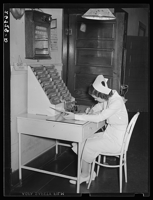 Nurse writing up charts. Herrin Hospital (private). Herrin, Illinois