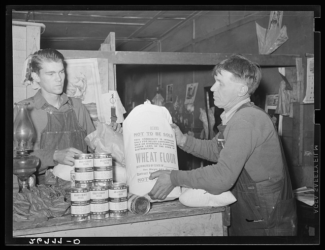 Unemployed miner with food from surplus commodities corporation. Zeigler, Illinois