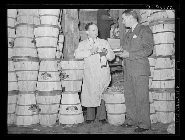 Commission merchants at Washington Market, New York City. Crates contain beans