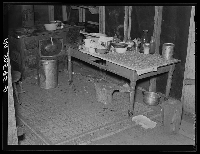 Corner of beet worker's home. Note corn drying on the table. Chaska, Minnesota