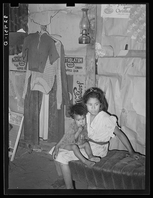 Mexican children living on outskirts of San Antonio, Texas. Notice the dirt floor