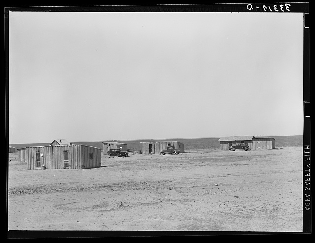 Homes of day laborers on large farm near Ralls, Texas. There are 4900 acres in this farm. Nine tractors are used